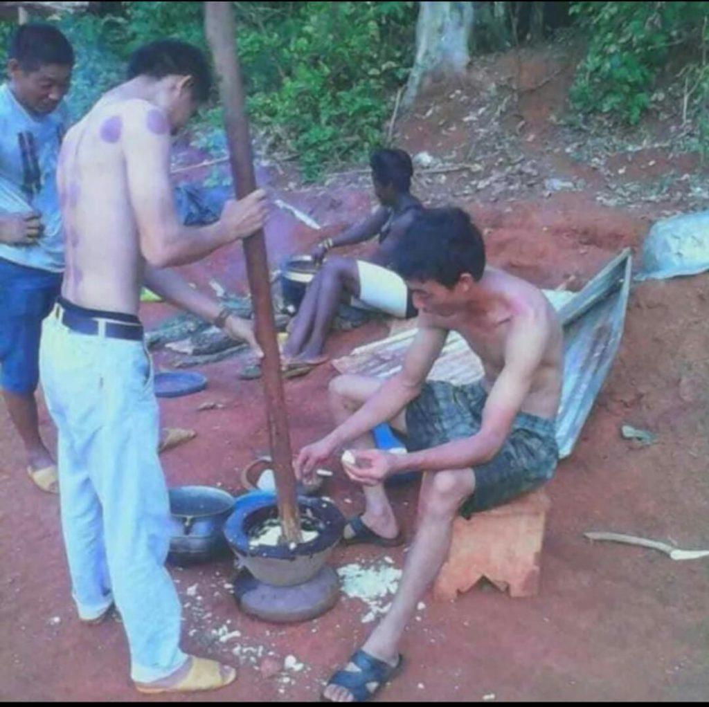 Photo of Chinese men preparing fufu in the bush causes stir. 52