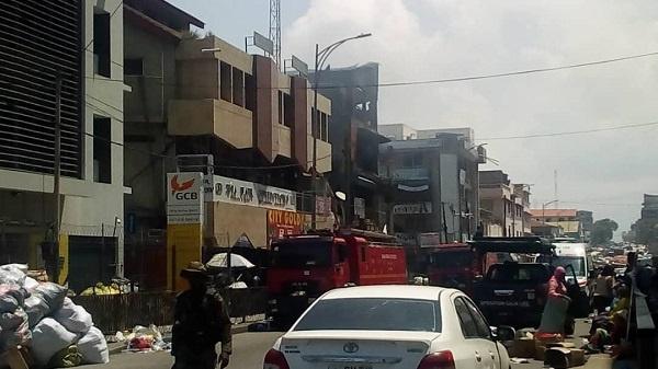 Makola market fire still smoldering after three days. 46